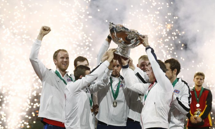 Team Britain winning the Davis Cup after Andy Murray defeated Belgium's David Goffin, rear right, in three sets, 6-3, 7-5, 6-3, during their singles Davis Cup final tennis match at the Flanders Expo in Ghent, Belgium, Sunday, Nov. 29, 2015. (AP Photo/Alastair Grant)