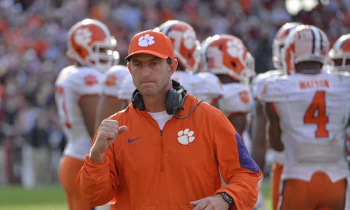 Clemson head coach Dabo Swinney reacts in the closing minutes of an NCAA college football game against South Carolina Saturday,  Nov. 28, 2015,  in Columbia,  S.C. Clemson won 37-32. (AP Photo/Richard Shiro)