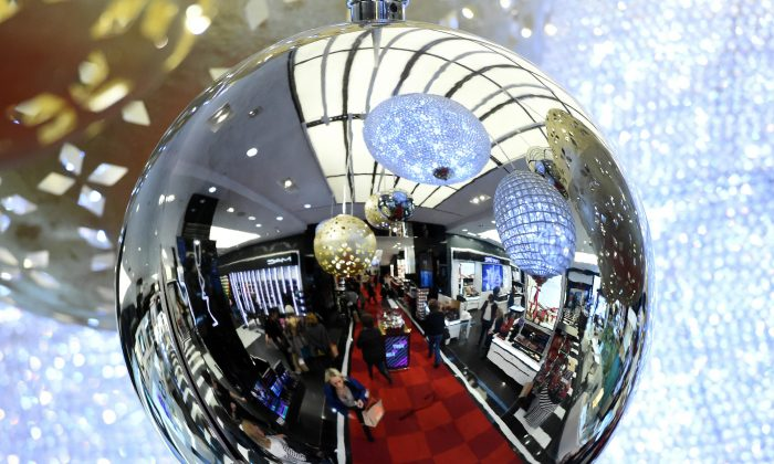 Shoppers are reflected in a Christmas decoration during Black Friday at Bloomingdale's Flagship store at 59th Street in New York City on Nov. 27, 2015. (Timothy A. Clary/AFP/Getty Images)