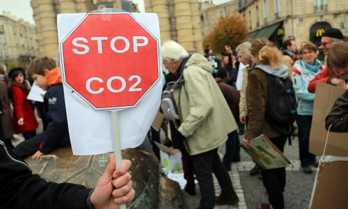 People rally in Bordeaux on Nov. 29, 2015, to protest against global warming a day ahead of the United Nations Conference on Climate Change (COP21) held in Paris. (Nicolas Tucat/AFP/Getty Images)