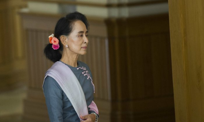 Chairperson of the National League for Democracy (NLD) Aung San Suu Kyi arrives for Myanmar's first Parliament meeting after the general elections, at Union Parliament in Naypyidaw on November 16, 2015.  Suu Kyi returned to parliament along with dozens of rivals freshly hammered by her pro-democracy party's landslide election victory as the legislature begins a overseeing the country's delicate transition.  AFP PHOTO / Ye Aung THU        (Photo credit should read Ye Aung Thu/AFP/Getty Images)