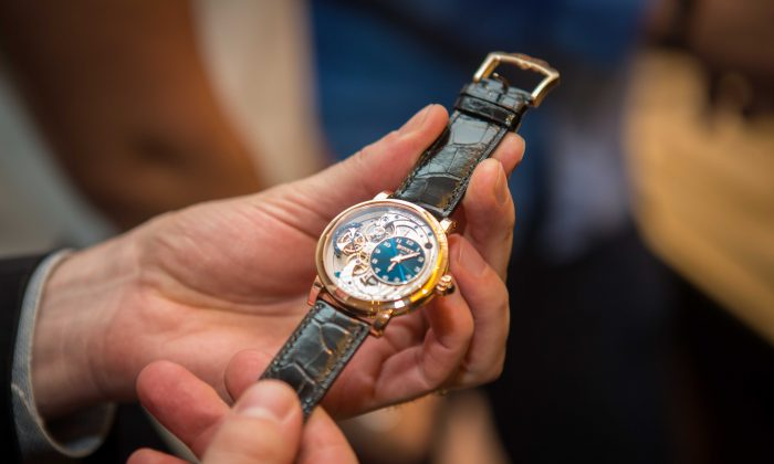 Luxury watch aficionados celebrate the unveiling of BOVET's newest location at the Asprey of London on Madison Avenue in New York City on Nov. 17, 2015. (Benjamin Chasteen/Epoch Times)