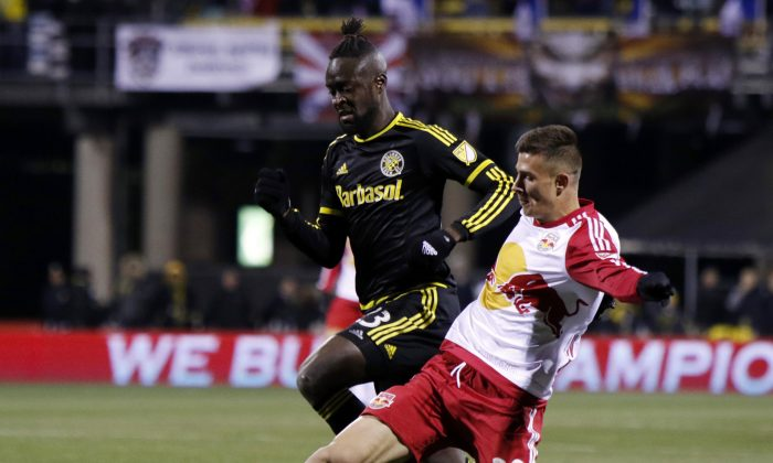 New York Red Bulls defender Matt Miazga, right, works for the ball against Columbus Crew forward Kei Kamara during the first half in the first leg of the MLS soccer Eastern Conference championship in Columbus, Ohio, Sunday, Nov. 22, 2015. (AP Photo/Paul Vernon)