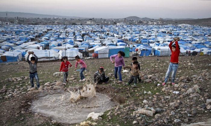 Syrian refugee children play at a temporary refugee camp in Irbil, northern Iraq, on Nov. 28, 2015. (AP Photo/Seivan M. Salim)
