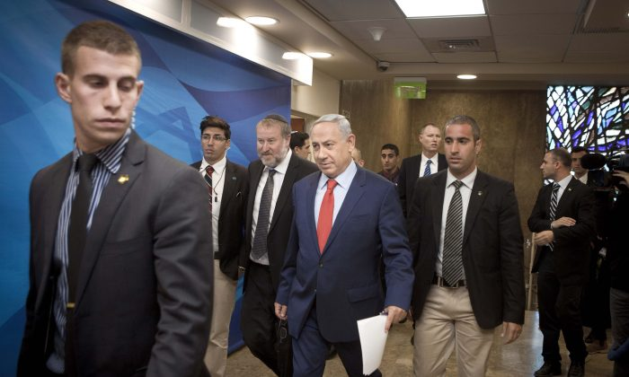 Israeli Prime Minister Benjamin Netanyahu arrives for the weekly cabinet meeting in Jerusalem on Nov. 29, 2015. (Dan Balilty/AP)