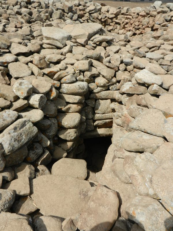 The dark entrance to the burial chamber found at the center of the megalithic site. (Ani Nimi/CC BY-SA)