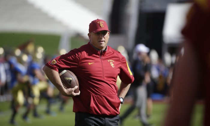 Southern California interim head coach Clay Helton watches his players during practice for an NCAA college football game against UCLA, Saturday, Nov. 28, 2015, in Los Angeles. (AP Photo/Jae C. Hong)