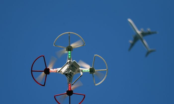 A drone is flown for recreational purposes as an airplane passes nearby in the sky above Old Bethpage, New York, on Sept. 5, 2015. (Bruce Bennett/Getty Images)