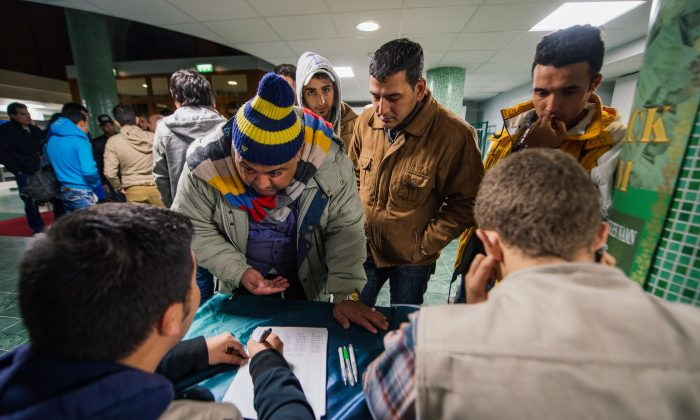 Refugee's register their names as they arrive to Stockholm central mosque in this October 2015 file photo. In the time since, Sweden has worked to stem the flood of migrants as tensions rise in many villages and towns across the country. (AFP/Getty Images)