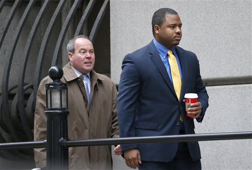 William Porter, right, one of six Baltimore city police officers charged in connection to the death of Freddie Gray, walks into a courthouse with his attorney Joseph Murtha for jury selection in his trial, Monday, Nov. 30, 2015, in Baltimore. Porter faces charges of manslaughter, assault, reckless endangerment and misconduct in office. (Rob Carr/Pool Photo via AP)