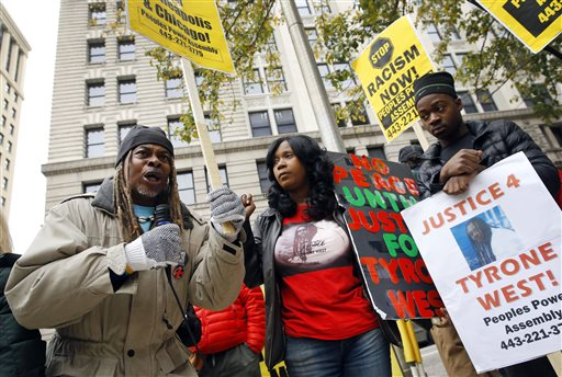 Protestors gather outside Clarence M. Mitchell Jr. Courthouse, Monday, Nov. 30, 2015. (AP Photo/Patrick Semansky)