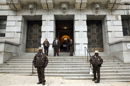 Members of the Baltimore City Sheriff's Office stand outside Clarence M. Mitchell Jr. Courthouse, Monday, Nov. 30, 2015, in Baltimore, after the arrival of William Porter, one of six Baltimore city police officers charged in connection to the death of Freddie Gray. Porter, whose trial jury selection began Monday, faces charges of manslaughter, assault, reckless endangerment and misconduct in office. (AP Photo/Patrick Semansky)