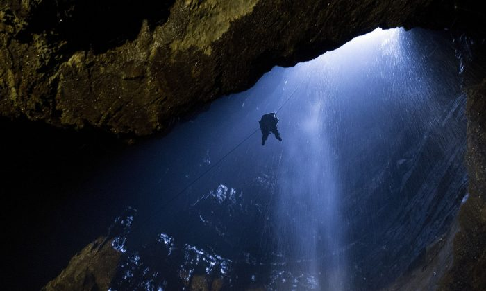 A member of the public is winched to the surface after visiting the Main Chamber of Gaping Gill, the largest underground cavern in Britain naturally open to the surface, near Ingleton, northern England, on May 26, 2015. (Oli Scarff/AFP/Getty Images)