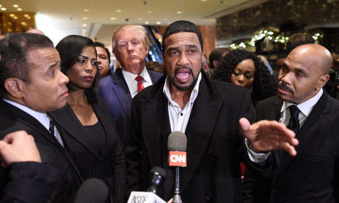 Republican Candidate Donald Trump(3rd-L) arrives to speaks to the press with Rev. Darrell Scott (C), senior pastor of the New Spirit Revival Center in Cleveland Heights after meeting with African American pastors at Trump Tower in New York November 30, 2015. (AFP/Getty Images)