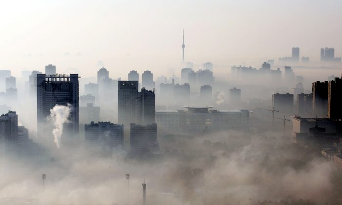 Buildings stand out amid a dense smog engulfing Wuhan, Hubei Province, China, on Dec. 3, 2009. (STR/AFP/Getty Images)
