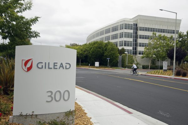 A man cycles near the headquarters of Gilead Sciences in Foster City, Calif., on July 9, 2015. (AP Photo/Eric Risberg)
