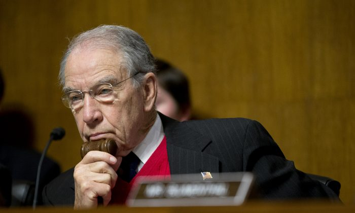 Senate Judiciary Committee Chairman Sen. Chuck Grassley (R-Iowa) holds the gavel close while listening to testimony by Puerto Rico Gov. Alejandro Javier Garcia Padilla on Puerto Rico's fiscal problems, Tuesday, Dec. 1, 2015, on Capitol Hill in Washington, D.C. Puerto Rico and its debt crisis takes center stage in Congress as its governor testifies before a Senate panel about the U.S. commonwealth's financial woes and the demands of creditors. (AP Photo/Pablo Martinez Monsivais)