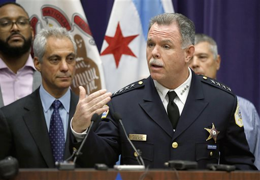 Chicago Police Superintendent Garry McCarthy (R) speaks about first-degree murder charges against police officer Jason Van Dyke in the death of 17-year-old Laquan McDonald, as Mayor Rahm Emanuel (L) looks, on Nov. 24, 2015. (AP Photo/Charles Rex Arbogast)