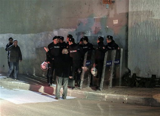 Riot police arrive after an explosion on a highway overpass near a subway station,  wounded five people and was caused by a bomb according to information given by the local mayor, in Istanbul, Turkey, Tuesday, Dec. 1, 2015. The bomb was left on barriers on the overpass, said Atilla Aydiner, the mayor for Istanbul's Bayrampasa district. (AP Photo/Cagdas Erdogan)