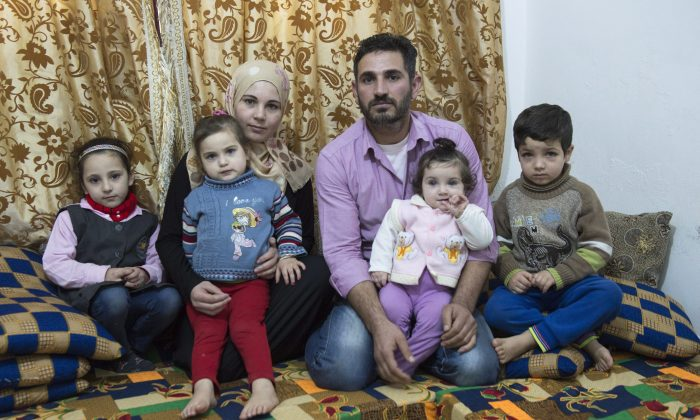 Syrian Refugee Samer Albqerat with his wife Doaa and their children on Dec. 1, 2015, in Irbid, Jordan. The family is waiting for approval to immigrate to Canada. (The Canadian Press/Paul Chiasson)