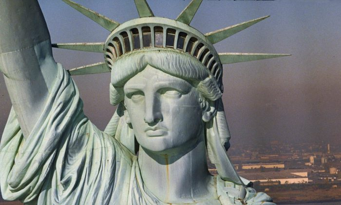 The newly renovated Statue of Liberty is seen, July 3, 1986, in New York Harbor.  (AP Photo)