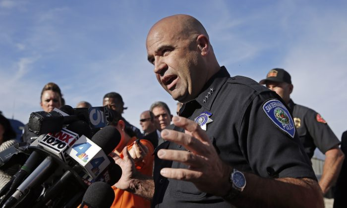 San Bernardino Police Chief Jarrod Burguan talks to the media near the the site of a mass shooting in San Bernardino, Calif., on Wednesday, Dec. 2, 2015. One or more gunmen opened fire Wednesday at a Southern California social services center, shooting several people as others locked themselves in their offices, desperately waiting to be rescued by police, witnesses and authorities said. Authorities said the shooting rampage killed multiple people and wounded others. (AP Photo/Chris Carlson)