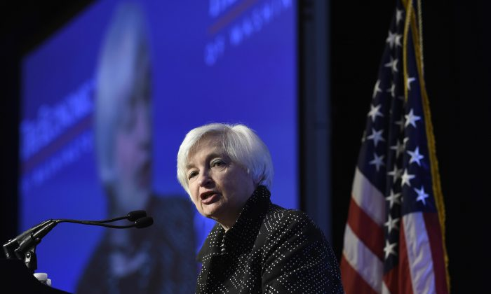 Federal Reserve Chair Janet Yellen speaks at the Economics Club of Washington in Washington, D.C., Wednesday, Dec. 2, 2015. Yellen indicated that the U.S. economy is on track for an interest rate hike this month, but the Fed will need to review incoming data before making a final decision. (AP Photo/Susan Walsh)