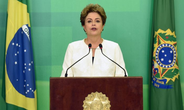 Brazil's President Dilma Rousseff delivers a speech at Planalto Palace in Brasilia on on Dec. 2, 2015. Brazil's lower house speaker triggered impeachment proceedings against President Dilma Rousseff on Wednesday, setting the stage for a political battle that could see the country's first female leader forced from office. (Evaristo Sa/AFP/Getty Images)