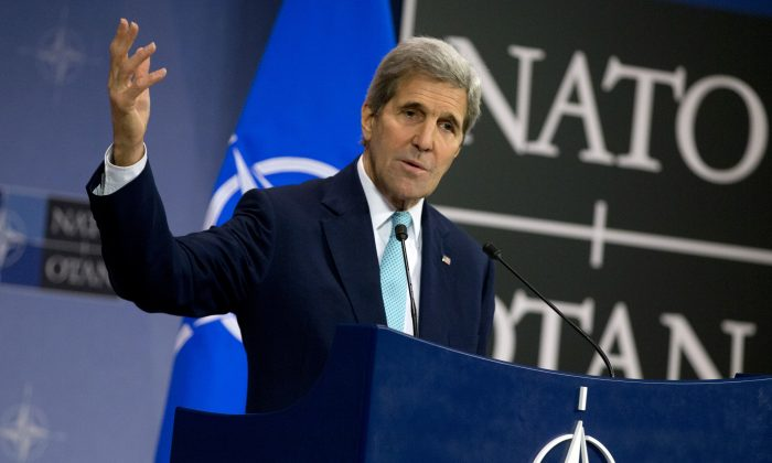 Secretary of State John Kerry speaks at a media conference at NATO headquarters in Brussels on Wednesday, Dec. 2, 2015. (AP Photo/Virginia Mayo)