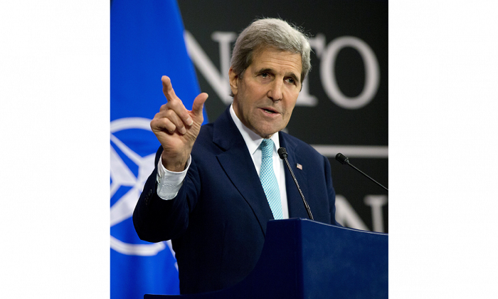 U.S. Secretary of State John Kerry speaks during a media conference at NATO headquarters in Brussels on Dec. 2, 2015. Kerry urged NATO members to step up military efforts against ISIS. (AP Photo/Virginia Mayo)