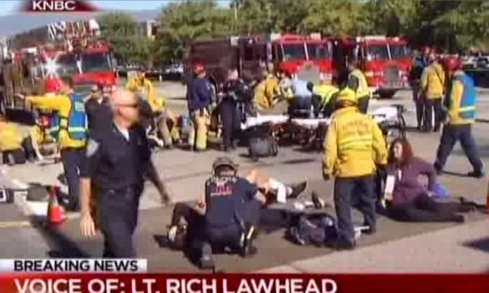First responders attend to people outside a Southern California social services center in San Bernardino, where one or more gunmen opened fire, shooting multiple people on Wednesday, Dec. 2, 2015. (KNBC via AP)
