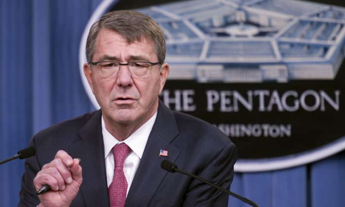 Defense Secretary Ash Carter gestures during a news conference at the Pentagon on Dec. 3, 2015, where he announced that he has ordered the military to open all combat jobs to women, and is giving the armed services until Jan. 1 to submit plans to make the historic change. (AP Photo/Cliff Owen)