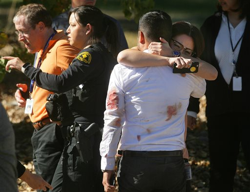 A couple embraces following a shooting that killed multiple people at a social services facility, Wednesday, Dec. 2, 2015, in San Bernardino, Calif. (David Bauman/The Press-Enterprise via AP)