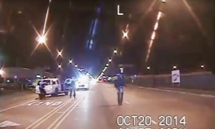 Frame from dash-cam video provided by the Chicago Police Department: Laquan McDonald (R) walks down the street moments before being shot by officer Jason Van Dyke in Chicago on Oct. 20, 2014. Amid an outcry after the city waited more than a year to release dash-cam footage of Officer Van Dyke shooting McDonald 16 times, Mayor Rahm Emanuel announced this week that he was setting up a special task force to examine, among other things, the city's video-release policy. (Chicago Police Department)