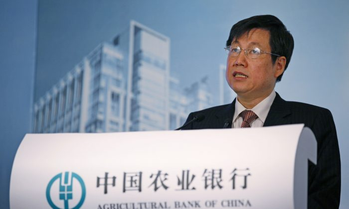Zhang Yun, vice chairman and president of the Agricultural Bank of China, at a news conference on its initial public offering in Hong Kong on June 29, 2010. Zhang, the head of China's fourth-largest state bank, has resigned citing personal reasons according to reports appearing Saturday, Dec. 5, 2015. (AP Photo/Kin Cheung)