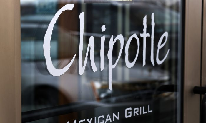 A Chipotle Mexican Grill in Robinson Township, Pa., on Jan. 28, 2014. Chipotle says it is tightening its food safety standards after its restaurants were linked to dozens of cases of E. coli. The Mexican food chain says it hired IEH Laboratories in Seattle to help improve its system after reports in late October 2015 that linked E. coli cases to its restaurants in Oregon and Washington. Since then, additional cases have been reported in California, Minnesota New York, and Ohio. (AP Photo/Gene J. Puskar)