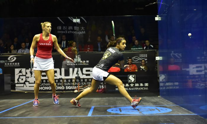 No 1 seed Raneem El Weilily of Egypt, plays a backhand volley in her semi-final match against No3 seed Laua Massaro in the Hong Kong Squash Open 2015 on Saturday Dec 5. Massaro won 11-5, 11-4, 11-8 to progress to the final. (Bill Cox/Epoch Times)