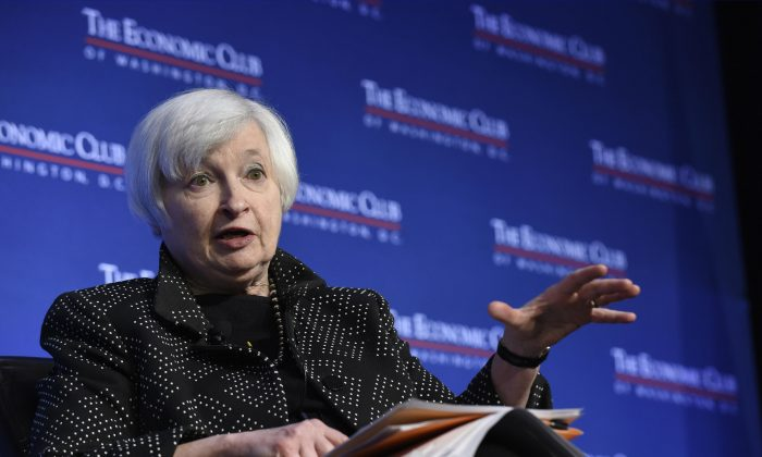 Federal Reserve Chair Janet Yellen speaks at the Economics Club of Washington in Washington, Wednesday, Dec. 2, 2015. Yellen indicated that the U.S. economy is on track for an interest rate hike this month, but the Fed will need to review incoming data before making a final decision. (AP Photo/Susan Walsh)