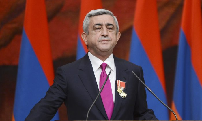 Armenian President Serzh Sargsyan is sworn in during his inauguration ceremony in Yerevan, Armenia, on April 9, 2013. Armenia was holding a referendum Sunday on proposed constitutional changes that would give more powers to the prime minister and parliament at the expense of the president, who would become largely a figurehead, but the opposition has seen the reform as an attempt by President Serzh Sargsyan to extend his rule. (Davit Hakobyan/PanArmenian via AP)
