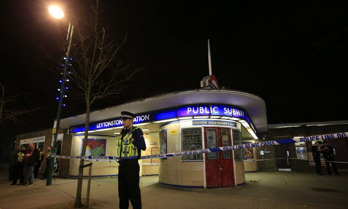 "Police cordon off Leytonstone Underground Station in east London following a stabbing incident, Saturday, Dec. 5, 2015. The stabbing is being treated as a ""terrorist incident,"" the London police said Saturday. The London police counter-terror command said in a statement that it is investigating the incident in which a man was threatening people with a knife at around 7 p.m. (1900 GMT; 2 p.m. EST). One person sustained serious injuries and two others received minor injuries. (Jonathan Brady/PA via AP)"