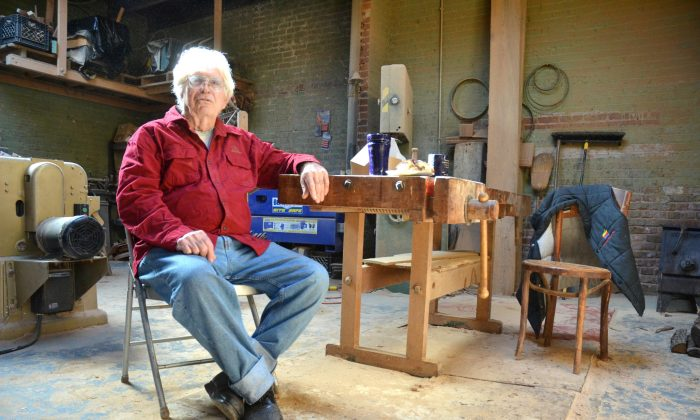 Sam Forrest on Nov. 21, 2015, at his Brookland Park Boulevard shop in Richmond, Va., where he made his latest collection of furniture. (Zachary Reid/Richmond Times-Dispatch via AP)