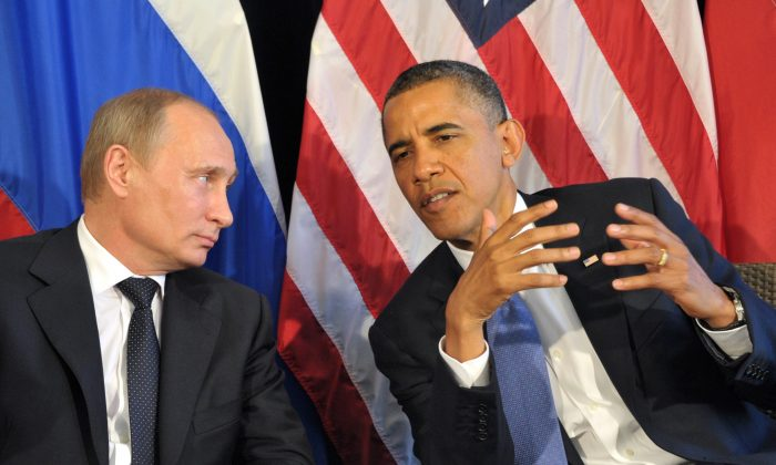 President Barack Obama (R) meets his Russian President Vladimir Putin (L) in Los Cabos, Mexico, on June 18, 2012, during the G20 leaders Summit to discuss differences over what to do about the bloody conflict in Syria. (Alexei Nikolsky/AFP/Getty Images)