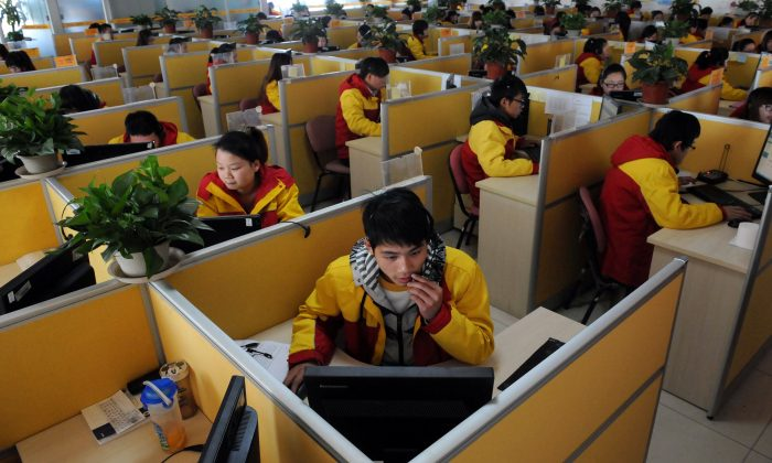 """Workers check deliveries in Beijing in 2013 the day after """"Singles Day,"""" which falls on Nov. 11 each year. Chinese are increasingly spending big in online shopping on Singles Day. (STR/AFP/Getty Images)"""