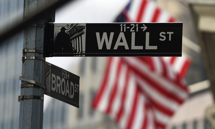 A Wall Street road sign near the New York Stock Exchange (NYSE) in New York City on Oct. 16, 2014. (Jewel Samad/AFP/Getty Images)