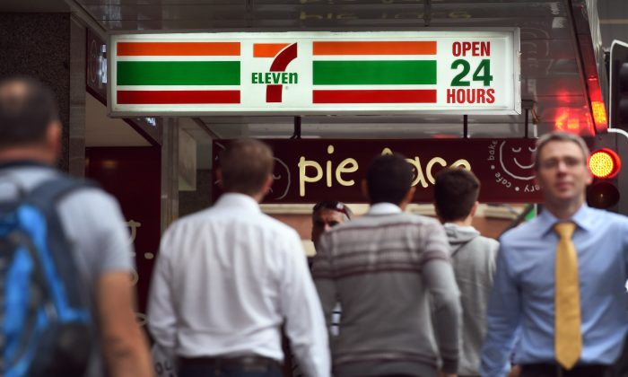 People walk past a 7-Eleven convenience store in Sydney's central business district in Australia, on Sept. 30, 2015. (William West/AFP/Getty Images)