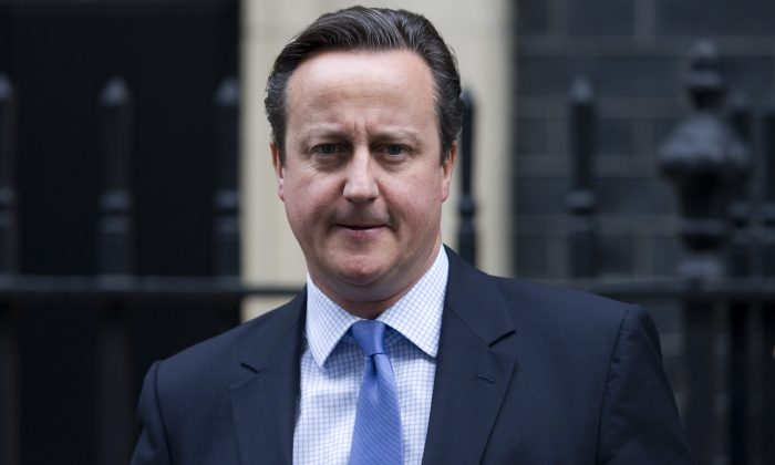 In this file photo, then British Prime Minister David Cameron leaves 10 Downing Street in central London on Dec. 2, 2015. (Justin Tallis/AFP/Getty Images)