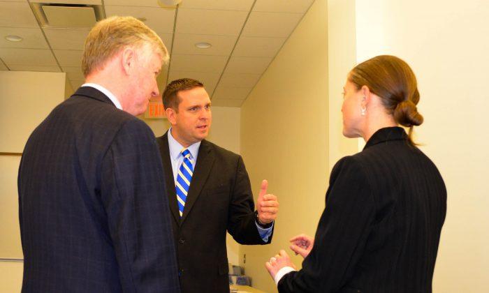 (L-R) Harry Porr, Steve Neuhaus, and Elizabeth Whitman in Goshen on Dec. 3, 2015. (Yvonne Marcotte/Epoch Times)