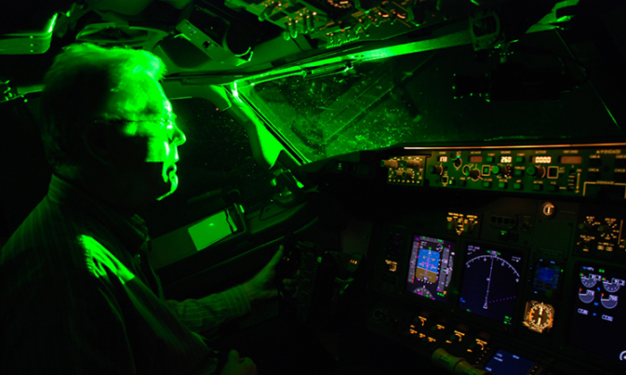This image by the FAA shows what happens when a laser pointer is aimed at a cockpit. Pointing a laser at an aircraft poses a serious safety risk and is against the law.
