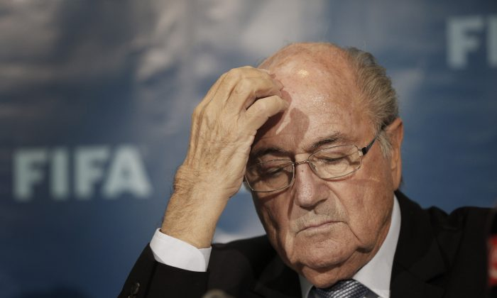 FIFA President Sepp Blatter gestures as he attends a news conference in Marrakech, Morocco, on Dec. 19, 2014. The FBI is investigating Blatter's role in a kickbacks scandal that involved his predecessor as FIFA president, Joao Havelange, the BBC reported on Dec. 6, 2015. (AP Photo/Christophe Ena)