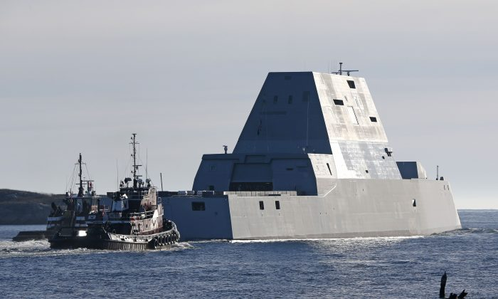 The first Zumwalt-class destroyer, the USS Zumwalt , the largest ever built for the U.S. Navy, leaves the Kennebec River, Monday, Dec. 7, 2015, in Phippsburg, Maine. The futuristic ship is headed out to sea for the first time to undergo sea trials.(AP Photo/Robert F. Bukaty)